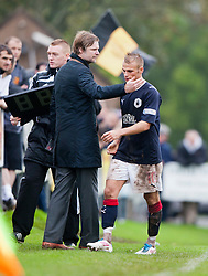 Falkirk's Kallum Higginbotham with Steven Pressley, Falkirk manager after being subbed..Annan Athletic 0 v 3 Falkirk. Semi Final of the Ramsdens Cup, 9/10/2011..Pic © Michael Schofield.