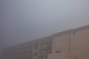 Buildings in La Mongie, ski resort, in a thick fog.