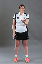 Umpire Rachael Radford signalling toss up