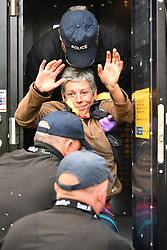 © Licensed to London News Pictures. 08/10/2019. London, UK. Extinction Rebellion activists being arrested after glueing themselves underneath a lorry outside DEFRA  in Westminster. Activists have converged on Westminster for a second day, blockading roads in the area and calling on government departments to 'Tell the Truth' about what they are doing to tackle the Emergency. Photo credit: Ben Cawthra/LNP