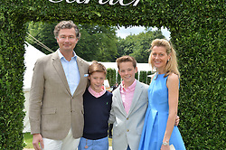LAURENT FENIOU MD of Cartier UK, his wife CARINE FENIOU and their children (L_R) CHARLES FENIOU & ALEX FENIOU at the Cartier hosted Style et Lux at The Goodwood Festival of Speed at Goodwood House, West Sussex on 26th June 2016.
