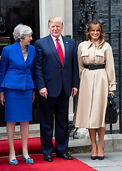 Donald Trump, US President and First Lady Melania Trump arrive in Downing Street as part of their State visit. Theresa May, Prime Minister and Mr May greet them on the doorstep of No.10 Downing Street, London, Great Britain <br /> 4th June 2019 <br /> L to R: <br /> <br /> Theresa May <br /> Donald Trump<br /> Melania Trump <br /> <br /> <br /> Photograph by Elliott Franks