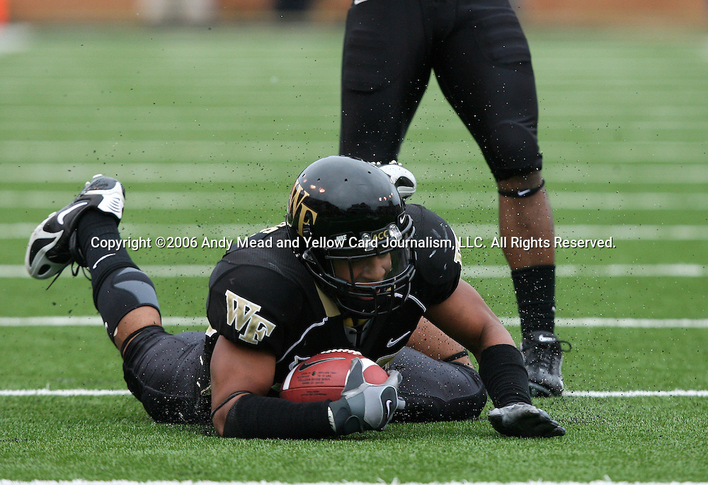 07 October 2006: Wake Forest's Patrick Ghee sends up a spray of black rubber pellets after returning an interception to the Clemson 12 yard line in the third quarter. The Clemson University Tigers defeated the Wake Forest University Demon Deacons 27-17 at Groves Stadium in Winston-Salem, North Carolina in an Atlantic Coast Conference NCAA Division I College Football game.