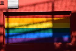 Rainbow flag on window of gay club, Norwich, Norfolk UK