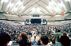 Interior of the Venue before the start of the Grateful Dead in Concert at the Carrier Dome, Syracuse University, New York on the 20th of October 1984. Photographed Dead Center Rear view Forward.