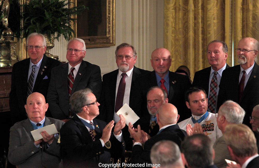 Members of  former Specialist Five James C. McCloughan unit stand up as President Donald Trump presenting the Medal of Honor to former Specialist Five James C. McCloughan, U.S. Army.in the East Room of the White House on July 31, 2017<br />Photo by Dennis Brack
