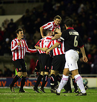 Photo. Andrew Unwin.<br /> Sunderland v Rotherham, Coca-Cola Championship, Stadium of Light, Sunderland 22/02/2005.<br /> Sunderland's Gary Breen (#5) is mobbed by his team-mates after scoring their third goal.