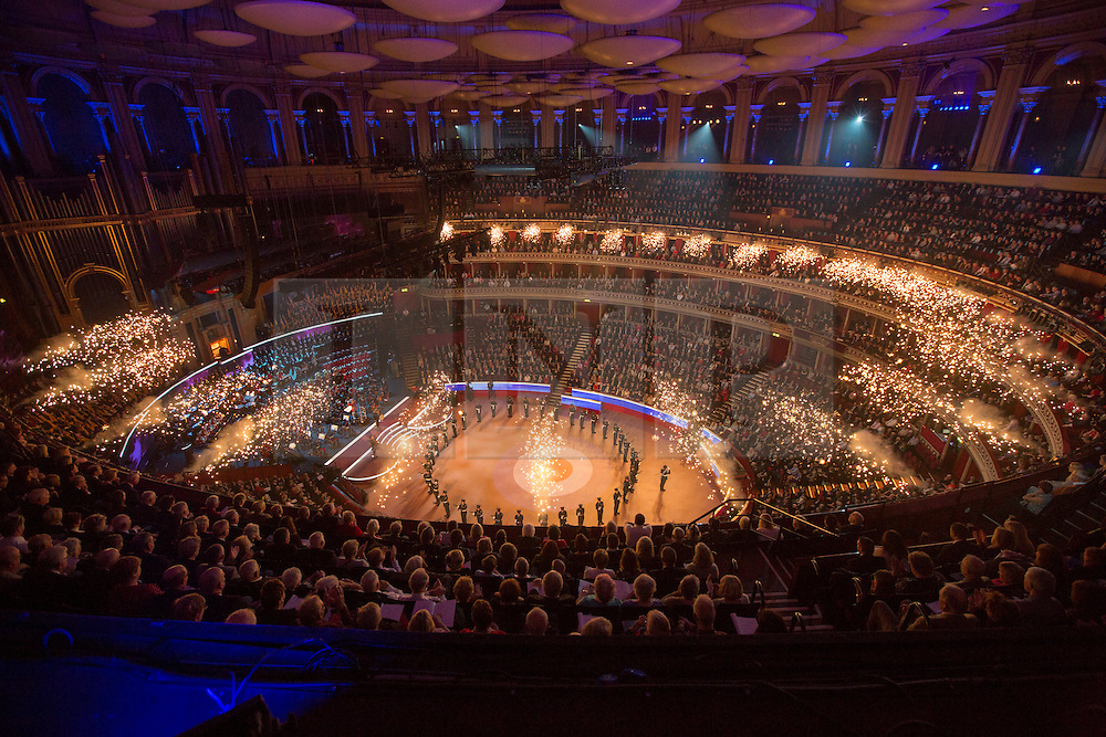 © Licensed to London News Pictures. 08/11/2014.  London.Members of the RAF Queens Colour Squadron perform in the arena of the Royal Albert Hall as they during the annual Festival of Remembrance.  First broadcast in 1927 the festival has now been held in the Royal Albert Hall for 87 years.     Photo credit : Alison Baskerville/LNP