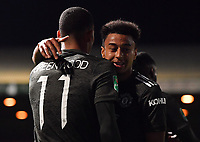 Football - 2020 / 2021 EFL Carabao Cup - Round Three - Luton Town vs Manchester United<br /> <br /> Manchester United's Jesse Lingard congratulates Mason Greenwood after he scores the third goal, at Kenilworth Road.<br /> <br /> COLORSPORT/ASHLEY WESTERN
