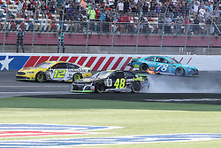 September 30, 2018 - Charlotte, NC, U.S. - CHARLOTTE, NC - SEPTEMBER 30:  #78: Martin Truex Jr., Furniture Row Racing, Toyota Camry Auto-Owners Insurance and #48: Jimmie Johnson, Hendrick Motorsports, Chevrolet Camaro Lowe's for Pros crash while #12: Ryan Blaney, Team Penske, Ford Fusion Menards/Pennzoil pushes through them to win the Monster Energy NASCAR Cup Series Playoff Race Bank of America ROVAL 400 on September 30, 2018, at Charlotte Motor Speedway in Concord, NC. (Photo by Jaylynn Nash/Icon Sportswire) (Credit Image: © Jaylynn Nash/Icon SMI via ZUMA Press)
