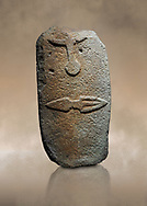 Late European Neolithic prehistoric Menhir standing stone with carvings on its face side. The representation of a stylalised male figure starts at the top with the bottom of a carving of a falling figure with head at the bottom and 2 curved arms encircling a body above. at the bottom is a carving of a dagger running horizontally across the menhir. Excavated from Piscina 'E Sali V site,  Laconi. Menhir Museum, Museo della Statuaria Prehistorica in Sardegna, Museum of Prehoistoric Sardinian Statues, Palazzo Aymerich, Laconi, Sardinia, Italy. warm art background.<br /> <br /> Visit our PREHISTORIC PLACES PHOTO COLLECTIONS for more  photos to download or buy as prints https://funkystock.photoshelter.com/gallery-collection/Prehistoric-Neolithic-Sites-Art-Artefacts-Pictures-Photos/C0000tfxw63zrUT4