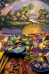 Asia, Thailand, Bo Sang village, near Chiang Mai. Colorful hand-painted fans are made from hand-split bamboo and paper