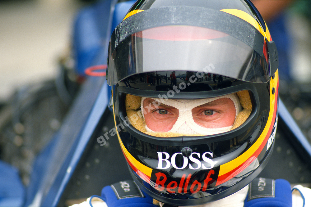 Stefan Bellof (Tyrrell-Ford) in the pits with his helmet on during practice for the 1985 Portugal Grand Prix in Estoril. Photo: Grand Prix Photo