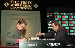 File photo dated 23-09-1993 of Russia's Garry Kasparov (right) and Britain's Nigel Short in action at the Times World Chess Championship, London.