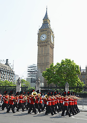 Guards make their way to form up ahead of the State Opening of Parliament, in the House of Lords at the Palace of Westminster in London.