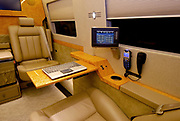 "How's that for a way to travel: Luxury limousine comes fitted out with drinks cabinet, computer system and even an exercise bike<br /> <br /> For most of us, taking a trip in the car means missing out on certain luxuries which we enjoy at home.<br /> However, for anyone wealthy enough to own this luxury limousine, that needs not be the case.<br /> The opulent vehicle comes fitted out with a number of incredible features, including a built-in exercise bike which can be used whilst sitting back in one of the leather seats.<br /> <br /> The vehicle also comes with a burr wood trimmings drinks cabinet, large screen HD television, surround sound system, wifi and computer system.<br /> There is also the option of armour plating for those high profile oligarchs or even politicians around the world who believe they need the security.<br /> The Cadillac Escalade ESV conversions vehicle has been made by US custom company Becker Automotive Designs.<br /> <br /> The vehicle costs between £83,500 and £161,000 depending on the final specifications.<br /> In advertising the vehicle, the company says: 'Gaining the edge in today's competitive business environment means using every minute of your busy day to its best advantage. <br /> 'The Becker Cadillac Escalade ESV allows you to transform travel time into some of the most tranquil, focused and productive time in your schedule.<br /> <br /> 'Powerfully equipped-with all of the comforts and amenities of the office at your fingertips, for those who appreciate the value of time.<br /> 'Manage correspondence, access the internet and get news and market updates on a full sized display integrated into the cabins Crestron-controlled privacy partition. <br /> 'Make calls and hold conferences when others simply cant. Becker's full mobile office suite allows voice and video communication any time.<br /> 'Conduct meetings in your quiet, spacious ""boardroom"" and even produce documents on demand.<br /> 'Take the rush out of rush hour. Spend your private time any way you like. Watch a movie, or just rest and relax in a spacious interior that no Euro"