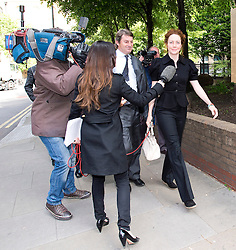 © London News Pictures. 05/06/2013. London, UK. REBEKAH BROOKS (right), Former CEO of News International and former editor of the News of The Worlds arriving Southwark Crown Court in London with her husband CHALIE BROOKS (centre) where they are due to face charges relating to phone hacking at the News of The World. . Photo credit: Ben Cawthra/LNP