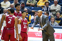 Nov 28, 2018; Morgantown, WV, USA; Rider Broncs head coach Kevin Baggett talks to his team during the first half against the West Virginia Mountaineers at WVU Coliseum. Mandatory Credit: Ben Queen-USA TODAY Sports