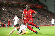 Liverpool forward Sadio Mane (10) battles for possession with Sheffield United defender George Baldock (2) who appears to handle the ball but no penalty given  during the Premier League match between Liverpool and Sheffield United at Anfield, Liverpool, England on 2 January 2020.