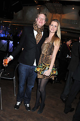 CHLOE DELEVINGNE and ED GRANT at the Wild for WSPA dinner in aid of the charity World Society for the Protection of Animals held at Under The Bridge, Stamford Bridge, Fulham Road, London on 23rd February 2012.