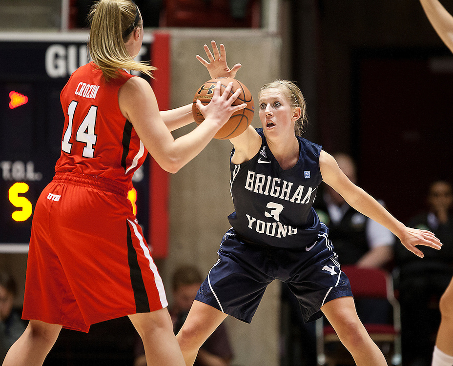 BYU guard Ashley Garfield (3) puts a hand in the face of Utah guard Paige Crozon (14) during the first half of the NCAA Women's Basketball game between Utah and BYU at the Jon M. Huntsman Center, Saturday, Dec. 8, 2012.