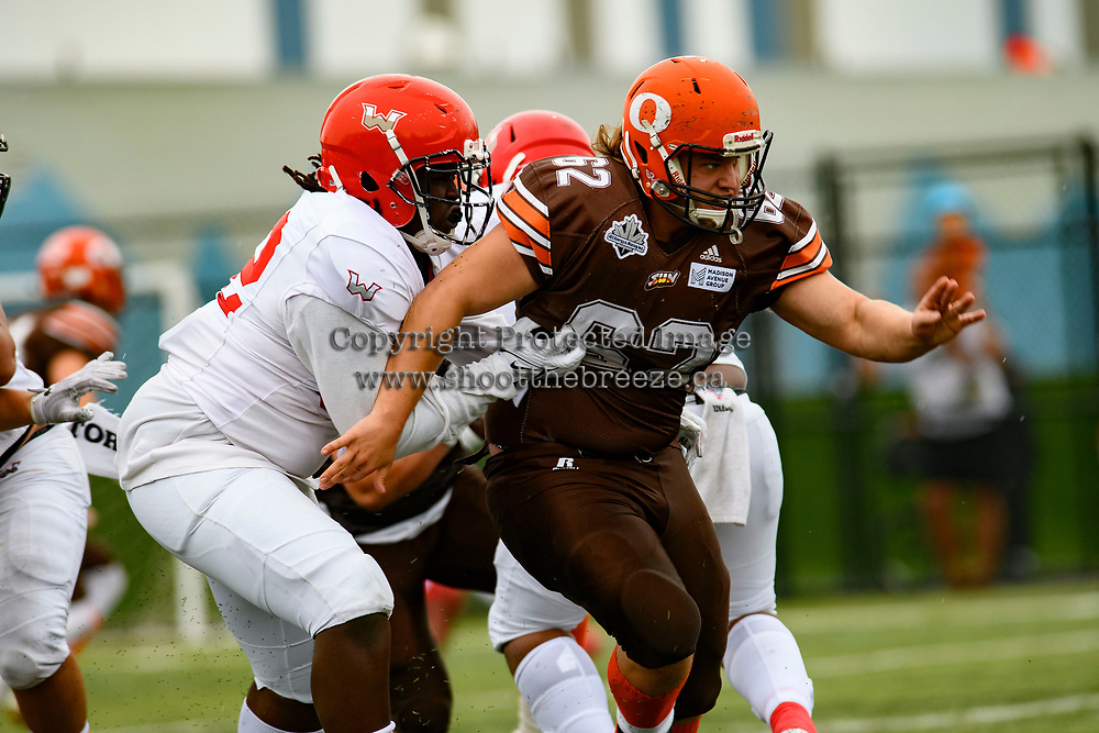 CHILLIWACK, BC - SEPTEMBER 11: A player of the Westshore Rebels attempts to tackle JJ Heaton #62 of Okanagan Sun at Exhibition Stadium in Chilliwack, BC, Canada. (Photo by Marissa Baecker/Shoot the Breeze)