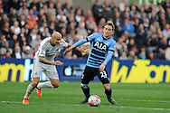 Jonjo Shelvey of Swansea city (l) challenges Christian Eriksen of Tottenham. Barclays premier league match, Swansea city v Tottenham Hotspur at the Liberty Stadium in Swansea, South Wales on Sunday 4th October 2015.<br /> pic by  Andrew Orchard, Andrew Orchard sports photography.