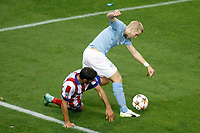 Atletico de Madrid´s Raul Garcia (L) and Malmo´s Tinnerholm during Champions League soccer match between Atletico de Madrid and Malmo at Vicente Calderon stadium in Madrid, Spain. October 22, 2014. (ALTERPHOTOS/Victor Blanco)