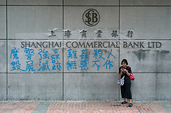 Kowloon, Hong Kong, China,. 7 October, 2019. After a night of violent confrontations between police and pro-democracy protestors in MongKok and YauMaTei in Kowloon, many MTR railway stations and what are thought to be pro-Beijing business franchises were vandalised. Vandalised Chinese owned Shanghai Commercial Bank.