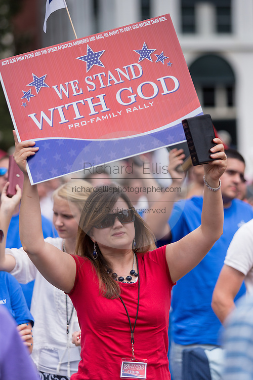 """Evangelical Christians wave signs and bibles during the """"Stand With God"""" rally  August 29, 2015 in Columbia, SC. Thousands of conservative Christians gathered at the State House to rally against gay marriage and listen to GOP presidential candidates Gov. Rick Perry and Sen. Ted Cruz speak."""