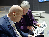 Garden City, New York, U.S. November 14, 2019. L-R, Apollo 10 Commander Lt. Gen. Thomas Stafford looks at his 1962 NASA class photo that MICHELE MASON, of Manhattan, brought to show him at the  17th Annual Cradle of Aviation Museum Air and Space Gala. When he was inducted to NASA class of 1962 astronauts, Mason wrote to Stafford, who sent her his photo.