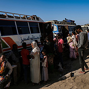 HAMDAYET, SUDAN - DECEMBER 7, 2020:  Refugees from the Tigray region of Ethiopia board buses to a Um Rakuba refugee camp  after spending days to weeks at a UNHCR reception center located in the east Sudanese border village of Hamdayet on December 7, 2020 in Hamdayet, Sudan. Last week, the Ethiopian government declared victory in its nearly month long battle with the Tigray People's Liberation Front (TPLF), which sent 45,000 people fleeing to Sudan and displaced thousands more within the Tigray Region. In recent days, Ethiopian forces have prevented even more people from crossing the border into Sudan, while a TPLF spokesman said that fighting had continued outside of Mekelle, Tigray's regional capital. (Photo by Byron Smith/Getty Images)