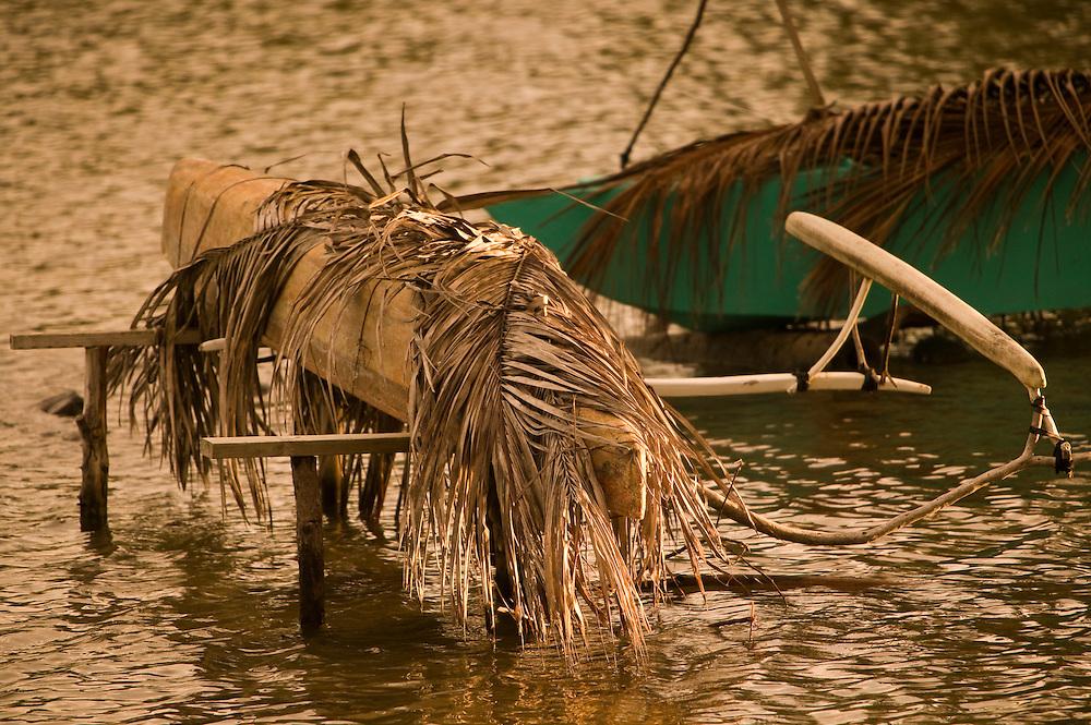 Huahine, French Polynesia, Maeva, stored fishing canoe