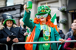 © Licensed to London News Pictures. 19/03/2017. London, UK. People celebrate St Patrick's Day as a parade goes through the streets of central London on Sunday, 19 March 2017. Photo credit: Tolga Akmen/LNP