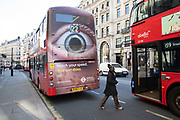 Bus with a giant eye on the back a road safety advertisement on Regent Street, in Londons main shopping and retail area normally full of thousands of shoppers and traffic is virtually deserted due to the Coronavirus outbreak on 23rd March 2020 in London, England, United Kingdom. Following government advice most shoppers are staying at home leaving the streets quiet, empty and eerie. Coronavirus or Covid-19 is a new respiratory illness that has not previously been seen in humans. While much or Europe has been placed into lockdown, the UK government has announced more stringent rules as part of their long term strategy, and in particular social distancing.