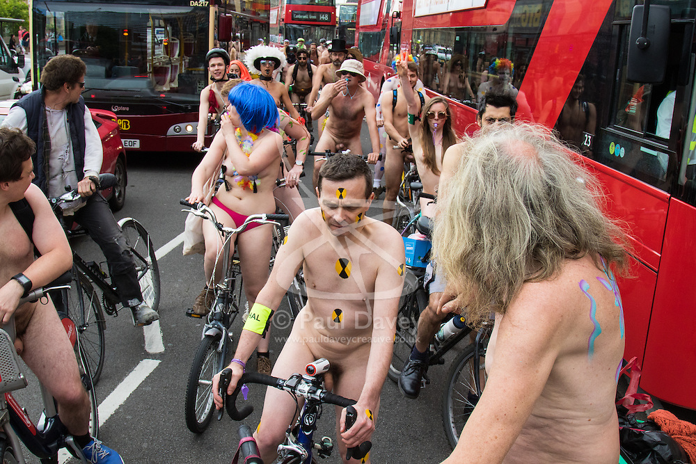 London, June 13th 2015. Hundreds of London cyclists take part in the World Naked Bike Ride, aimed at raising awareness about the safety of cyclists and calling for action on climate change.   // Contact for payment details: Paul Davey -  paul@pauldaveycreative.co.uk Tel: 07966016296.