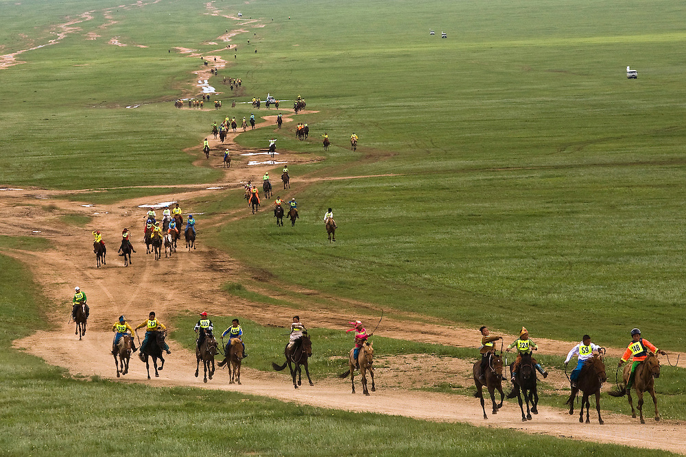 Mongolia - Edward Wong - Horse Race<br /> <br /> Boy jockeys participate in the horse race in Khui Doloon Khudag, Mongolia, July 10, 2008. Participants of this weekend's horse race during Naadam festival gather the area to practce. Children from 5 to 13 are chosen as jockeys. Photo by Shiho Fukada for The New York Times