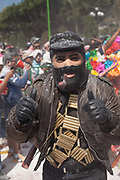 Carnival performer dressed as Subcomandante Marcos of the Zapatistas. The annual Carnival in Zoque Coiteco, a district of Chiapas in Southern Mexico happens in the five days preceeding Ash Wednesday along with Carnival throughout the Americas. Participants dress in colourful costumes with masks depicting famous political and entertainment figures, and throw talcum powder at each other.