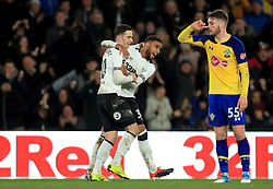 Derby County's Tom Lawrence (left) celebrates his side's second goal of the game with Jayden Bogle (centre) during the Emirates FA Cup, third round match at Pride Park, Derby.