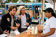 Queens, NY - October 2, 2016. Danny Miller (L) and Max Harwood of the band Lewis del Mar waiting for arepas from The Arepa Lady at The Feastival of Queens at The Meadows festival at Citi Field.