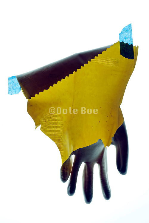 broken household working glove with blue tape