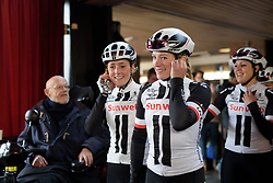 Julia Soek and Floortje Mackaij mirror poses on their way to sign in at Ronde van Drenthe 2017. A 152 km road race on March 11th 2017, starting and finishing in Hoogeveen, Netherlands. (Photo by Sean Robinson/Velofocus)
