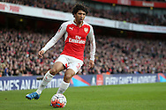 Mohamed Elneny of Arsenal in action. The Emirates FA cup, 4th round match, Arsenal v Burnley at the Emirates Stadium in London on Saturday 30th January 2016.<br /> pic by John Patrick Fletcher, Andrew Orchard sports photography.