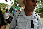 A protester wears a black piece of cloth on his shirt to protest of the ousting of Honduran president Manuel Zelaya a year after he was flown into exile by the military. There are still pockets of Hondurans who want the president returned to power, while most claim that things are better off since the coup d'etat.   Honduras is considered the third poorest country in the Western Hemisphere (Haiti, Nicaragua). With over 50% of the population living below the poverty line and 28% unemployed, Hondurans frequently turn to illegal immigration as a solution to their desperate situation. The Department of Homeland Security has noted an 95% increase in illegal immigrants coming from Honduras between 2000 and 2009, the largest increase of any country.