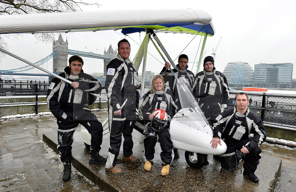 © Licensed to London News Pictures. 22/01/2013. London, United Kingdom. Injured servicemen bid for world-first antarctic mission.  A team of injured servicemen are to attempt a world first microflight to the south pole. Pictured R to L Capt Martin Hewitt, Capt Luke Sinnott, Flt Lt Kat Janes, Pte Nathan Foster, Former Lcpl Jamie Hull, Cpl Alan Robinson. Photo credit : Justin Setterfield/LNP