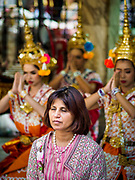 31 DECEMBER 2018 - BANGKOK, THAILAND: A woman prays in front of dancers at the Erawan Shrine in Bangkok. People make offering at the shrine by paying dancers to perform while they pray. The shrine was packed with tourists and Thais praying and making merit on New Year's Eve. Many Thais go to temples to meditate and pray on New Year's Eve.    PHOTO BY JACK KURTZ