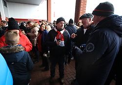 """Fans stuck outside the stadium due to a power cut prior to the Premier League match at the bet365 Stadium, Stoke. PRESS ASSOCIATION Photo. Picture date: Saturday December 16, 2017. See PA story SOCCER Stoke. Photo credit should read: Mike Egerton/PA Wire. RESTRICTIONS: EDITORIAL USE ONLY No use with unauthorised audio, video, data, fixture lists, club/league logos or """"live"""" services. Online in-match use limited to 75 images, no video emulation. No use in betting, games or single club/league/player publications."""
