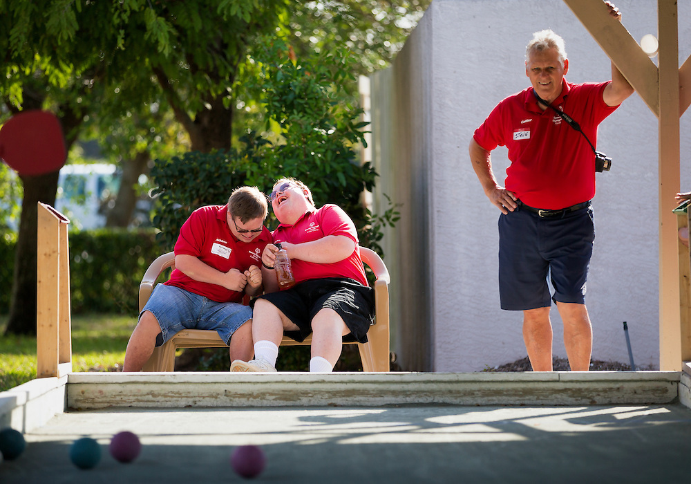 Naples residents Joshua McClellan, left, and, Jeffrey Wohlers, compete in an impromptu nudging match while waiting for their turn in a bocce match for the Special Olympics of Collier County on March 7, 2015, at the Naples Italian American Club in North Naples.