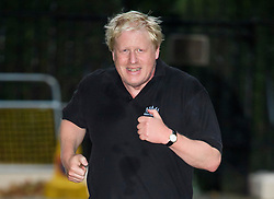 © Licensed to London News Pictures . 09/10/2017. London, UK.  British foreign secretary BORIS JOHNSON running in Westminster, London on October 9, 2017. Recent newspaper reports have suggested that Boris Johnson might be sacked as foreign secretary in a show of strength by British prime minister Theresa May.. Photo credit: Ben Cawthra/LNP