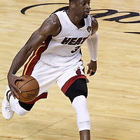 19 June 2012: Miami Heat shooting guard Dwyane Wade (3) dribbles during the Miami Heat 104-98 victory over the Oklahoma City Thunder, in Game 4 of the 2012 NBA Finals, at the AmericanAirlinesArena, Miami, Florida, USA.